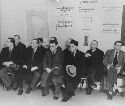 Jews waiting at the Relief Organization of German Jews - on the wall a map of South America and a sign about Palestine - Berlin 1935